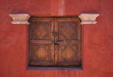 Old histiric window with woden shutters. Photographed at the beautiful Monastery of Santa Catalina, Arequipa, Peru stock images