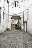 Old and historic alley in Lisbon Royalty Free Stock Photography