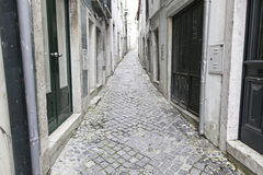 Old and historic alley in Lisbon Stock Image