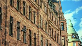 Old, historic ancient building of Stockholm, Sweden. Traditional architectural apartment and sky stock video footage