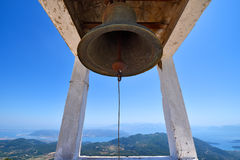 An old historic bell hanging above the island of Lefkada Stock Photography