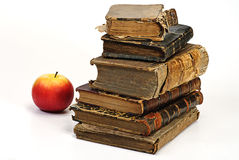 Old historic book and apple Royalty Free Stock Photos