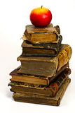 Old historic book and apple Stock Images