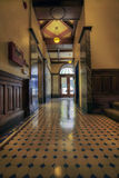 Old Historic Building Lobby. Foyer Area with tile floor, marble, and wood molding Stock Image
