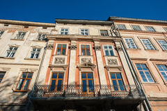 Old historic building with windows on the street Royalty Free Stock Photography