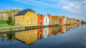 Old historic buildings along the river Nidelva in Trondheim Stock Photography