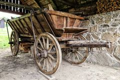 Old historic cart-ladder wagon. In the roofed barn Stock Photos