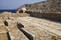 Old historic cemetery under the Spinalonga fortress. Greek ancient cemetery on the island. Chapel and burial place of the dead.  royalty free stock photos