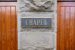 Old Historic Church Chapel Doors. Wood doors and a sign that says chapel at a very old historic church in an urban setting royalty free stock image