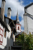 Old historic church spire and houses in Ediger Germany. Historic church spire and houses in Ediger Mosel Germany Stock Photo