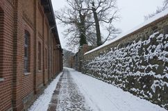 Old Historic City Walls. Narrow lane between old historic city walls and brick buildings, Neubrandenburg, Mecklenburg, Germany, in winter Royalty Free Stock Photo