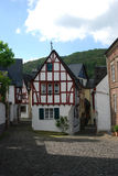 Old historic cobbled street and woodframed houses in Ediger Germ. Old historic cobbled streetand woodframed house in Ediger Mosel Germany Royalty Free Stock Photo