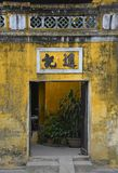 Doorway in Hoi An. An old historic doorway leading to a courtyard in the UNESCO listed central Vietnamese town of Hoi An Stock Images