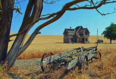 Old Historic Fairfield House and Wagon. I waited all year till the Wheat was golden to take this photo Royalty Free Stock Images