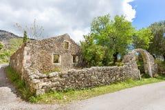 Old historic house as ruins along road Royalty Free Stock Image