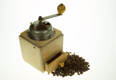 Old, historic, manual coffee grinder on isolated white Royalty Free Stock Photo