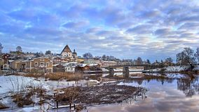 Old historic Porvoo, Finland with wooden houses and medieval stone and brick Porvoo Cathedral at blue hour sunrise stock photography