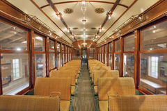 Old Historic Restored Tram Public Section. Old Historic Restored Tram Interior with Wood Bench Seats in General Public Non Smoking Section Stock Photo