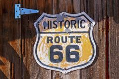 Historic route 66 sign on wooden background stock images