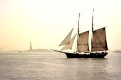 Old Historic Sailing Boat passing by Lady Liberty Statue Royalty Free Stock Image
