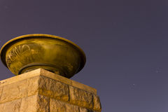 Old historic statue with a large bowl-like fire lamp at night in Letna park, Prague, Czech republic Stock Photography