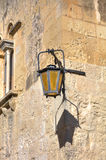 Old historic street lamp on the corner in the streets of the historic city of Mdina, the historic capital of Malta.  Stock Photos