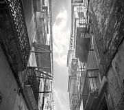 Old Historic Town in Malta. Looking at the sky through a very classical and narrow street in Birgu, Malta Royalty Free Stock Photos