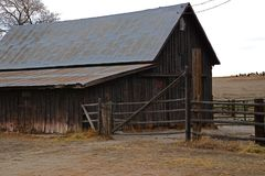Old Historic Wooden Barn. With a Tin Roof Out in the Country Stock Image