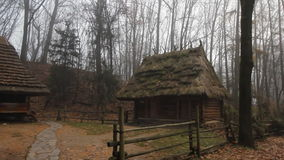 Old historic wooden buildings with thatched roof early in the foggy morning stock video