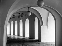 Old historical arcade at Little Square in Old Town, Prague, Czech Republic. Black and white image Stock Images
