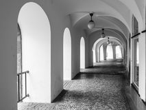 Old historical arcade at Little Square in Old Town, Prague, Czech Republic. Black and white image Stock Image