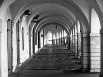 Old historical arcade in Loretanska Street near Prague Castle, Prague, Czech Republic. Black and white image Royalty Free Stock Photo