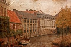 Old historical Brugge buildings from a boat Stock Image