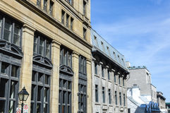 An old historical building with the large windows. In the old port of Montreal, Canada Stock Photo