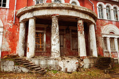 Old historical building with white columns. Old destroyed historical building with white columns Stock Photo