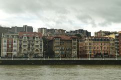 Old And Historical Buildings Of 1900 Beginnings Viewed From Portugalete To Sunrise. Architecture History Travel. March 25, 2018. Bridge of Getxo Vizcaya Basque royalty free stock photography
