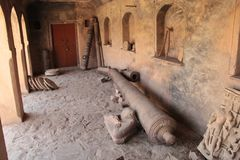 Old historical cannon barrel lying in India. Two decorated cannon barrels of medieval Mughal era kept in upright position in Hammir palace inside Ranthambor fort Royalty Free Stock Photo
