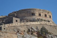 The old fortress of Spinalonga Island. The old historical fortress of the Island Spinalonga nearby Crete Island. The island was the home of a leper colony Royalty Free Stock Images