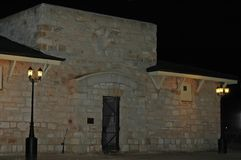 Old Historical Jail Circa 1920 made out of stone. Old Jail night time photo. Stone mason built jail with local stone. Sheep thieves and murderers stock photography