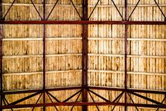 Wooden roof, visible red rafters and light brown laths. Old historical roof in wastewater treatment plant stock images