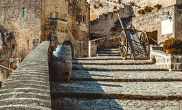 Old historical scene with wood wagon and wine barrels typical tool used in Matera in the past, old style Stock Photo
