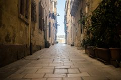 Old Historical Streets in Birgu Malta. A historical old narrow street and old houses in Birgu, Malta Stock Images