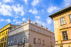 The old, historical tenements at the Old Market Square in Cracow, Poland Royalty Free Stock Photo