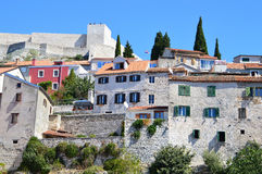 The Old Historical Town of Šibenik, Croatia. The historical town of Šibenik with its old fortress and tall stone-built houses in a sunny day Stock Image