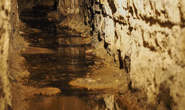 Old historical underground stream sewer Royalty Free Stock Images