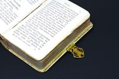 Old history book. An open old history book on black background Royalty Free Stock Image
