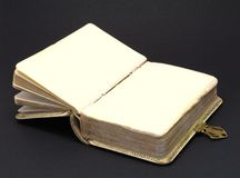 Old history book. An open old history book on black background Royalty Free Stock Photos