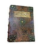 The old history book in a leather cover. Vintage book cover with beautiful decoration. The old history book in a leather cover Stock Photography