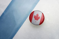 Old hockey puck with the national flag of canada. royalty free stock photos