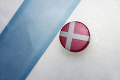 Old hockey puck with the national flag of denmark Royalty Free Stock Photo